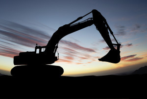silhouette of Excavator loader at construction site with raised